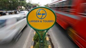A sign of Larsen and Toubro (L&T) is placed on a road divider in Mumbai, India May 25, 2016. REUTERS/Shailesh Andrade/File Photo
