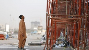 REPRESENTATIVE PHOTO: An Indian labourer looks at the construction site of a building in Riyadh November 16, 2014. REUTERS/Faisal Al Nasser /Files