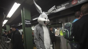 A participant in the Village Halloween Parade dressed as Bugs Bunny waits to ride the subway at the Times Square stop in the Manhattan borough of New York October 31, 2014. REUTERS/Carlo Allegri