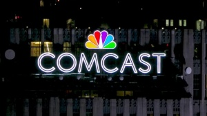 The NBC and Comcast logo are displayed on top of 30 Rockefeller Plaza, formerly known as the GE building, in New York, New York, U.S. on July 1, 2015. REUTERS/Brendan McDermid/File Photo