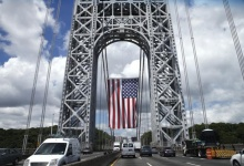 A giant American flag hangs from the West tower of the George Washington Bridge in between New York and New Jersey REUTER/Mike Segar