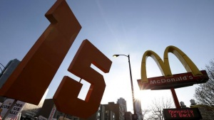 Demonstrators march past a McDonald's restaurant during a protest calling for a $15-an-hour nationwide minimum wage in downtown Chicago, Illinois, United States, April 14, 2016. REUTERS/Jim Young