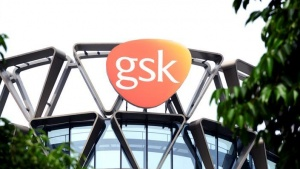 The GlaxoSmithKline (GSK) logo is seen on top of GSK Asia House in Singapore, March 21, 2018. Picture taken March 21, 2018. REUTERS/Loriene Perera