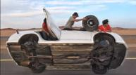 Stuntmen race cars - on only two wheels