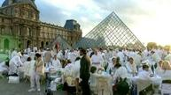 White-clad diners flock to the Louvre