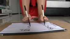 Woman writes with hands and feet simultaneously