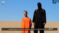 (GRAPHIC IMAGES) Islamic State video purports to show beheading of British hostage David Haines