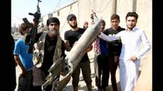 Islamic State fighters shoot down a Syrian warplane
