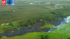 Lava flow creeps closer to houses in Hawaii