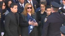Widow of slain NYPD offi