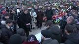 While the dead are buried, a war of words erupts over Ukraine