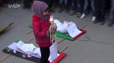 Children in Damascus stage mock funeral as they call for food and attention