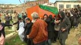 Afghans bury woman killed in mob attack