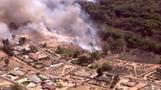 Brush fire threatens California buildings