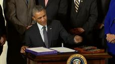 Obama signs trade bills into law