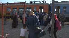 Migrants board north-bound train from Macedonia