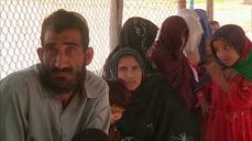 Afghan refugees return home reluctantly