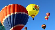 "Dozens of brightly colored hot air balloons take to the sky at US ""Balloon Fiesta"""