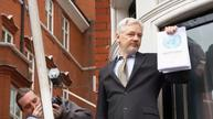 WikiLeaks' Assange greets supporters from embassy balcony