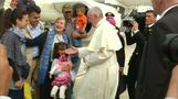 Pope returns with 12 refugees after visit to Greek camp