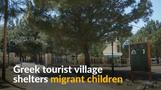 Migrant children cared for at abandoned Greek tourist village