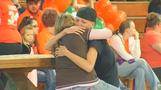 Hugs, tears at vigil for murdered Ohio family