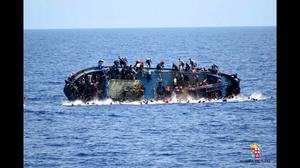 Italian navy says migrant boat flipped, five dead