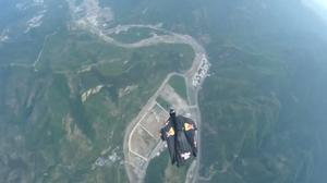 Flying man soars over China's Great Wall