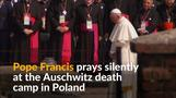 Pope Francis prays at Auschwitz