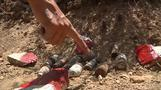 Cash cuts and violence hit Afghan demining