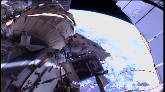 Debris shield floats away during spacewalk