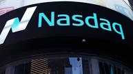 Earnings lift Nasdaq to record