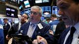 Wall St slips as Fed holds on rates