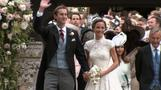 Newlyweds Pippa and James leave the church with their guests