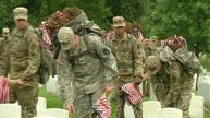 U.S. soldiers plant thousands of flags at cemetery in Memorial Day tradition