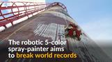 Robotic spray-painter creates huge multi-coloured mural