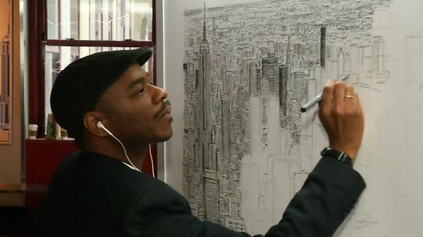 British autistic artist Stephen Wiltshire signs finished drawing of NYC skyline