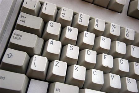 A computer keyboard is seen in a file photo. Italy has introduced a new law requiring Internet service providers to block child pornography Web sites within six hours of being told to do so, the communications ministry said on Tuesday. REUTERS/Catherine Benson