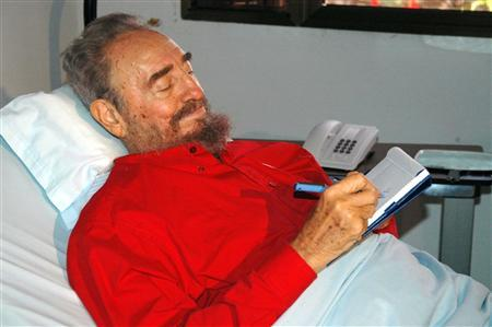 Cuba's President Fidel Castro writes while lying in bed in Havana in this August 13, 2006 file photo. Castro is in serious condition after complications following three failed operations on his large intestine for diverticulitis, the Spanish newspaper El Pais reported on Monday. REUTERS/Estudios Revolucion-Granma/Handout/Files