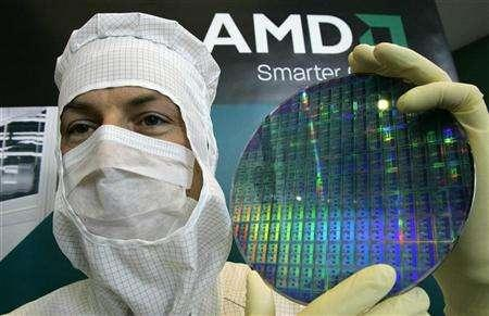 A technician of computer microprocessors maker AMD poses for the media with a wafer at the chip plant in Dresden October 24, 2006. REUTERS/Fabrizio Bensch