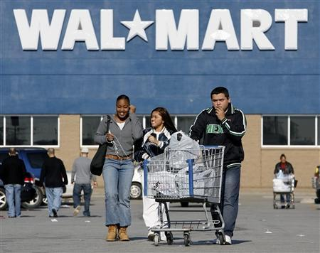 In this file photo shoppers leave a Wal-Mart store in Niles, Illinois, November 24, 2006. REUTERS/John Gress