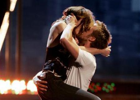 Actress Rachel McAdams and actor Ryan Gosling kiss on stage after winning the ''Best Kiss'' award for their screen kiss in the film ''The Notebook'' at the 2005 MTV Movie Awards in Los Angeles June 4, 2005. For everyone who's ever wanted to pucker up like a movie star, French kiss like Johnny Depp, or simply add variety to their love life, help is at hand. REUTERS/Fred Greaves