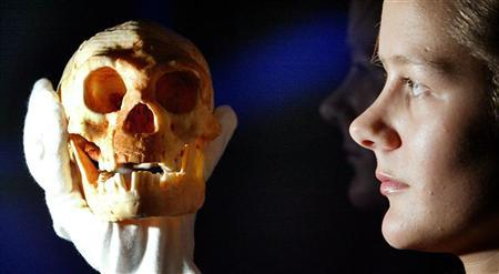A woman holds a model of a skull in a file photo. The Kansas Board of Education on Tuesday threw out science standards deemed hostile to evolution, undoing the work of Christian conservatives in the ongoing battle over what to teach U.S. public school students about the origins of life. REUTERS/File