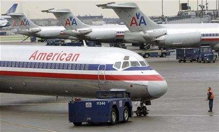 American Airlines planes sit on the tarmac at Chicago's O'Hare International Airport in this January 9, 2006 file photo. The resurgent U.S. airline industry may attract interest from cash-flush buyout firms, but rising valuations and entrenched unions could reduce the appeal. REUTERS/John Gress