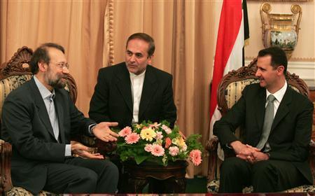 Syria's President Bashar al-Assad (R) meets Ali Larijani(L), secretary of Iran's Supreme National Security Council in Tehran February 18, 2007. REUTERS/Stringer