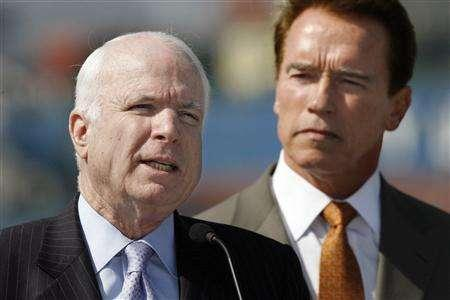Senator John McCain (R-Arizona) (L) and California Governor Arnold Schwarzenegger speak during a news conference about reducing greenhouse gasses at the Port of Los Angeles February 21, 2007. REUTERS/Mark Avery