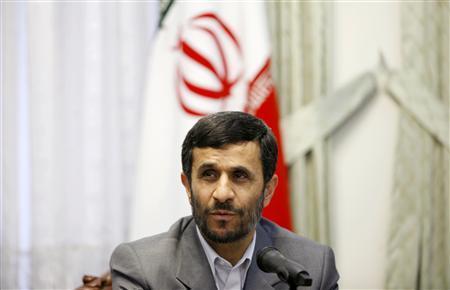 Iran's President Mahmoud Ahmadinejad attends a news conference in Tehran, February 18, 2007. REUTERS/Morteza Nikoubazl