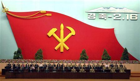 Guests sit at a national meeting to celebrate North Korean leader Kim Jong-il's 65th birthday in Pyongyang, February 15, 2007. REUTERS/Korea News Service