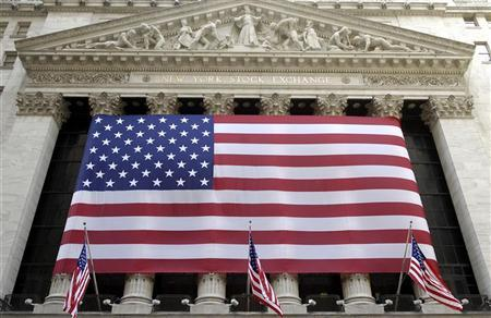 The U.S. flag is displayed on the front of the New York Stock Exchange February 9, 2007. The U.S. economy grew at a weaker-than-expected rate in the final three months of last year, the government's latest estimate on Wednesday showed, as businesses built fewer inventories and consumers spent less. REUTERS/Chip East