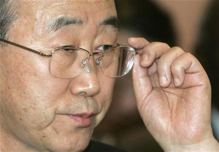 U.N. Secretary-General Ban Ki-moon adjusts his glasses as he listens to a journalist's question during a news conference in Vienna February 23, 2007. Climate change poses as much danger to the world as war, Ban said on Thursday as he pledged to make global warming the focus of talks with world leaders in June. REUTERS/Herwig Prammer